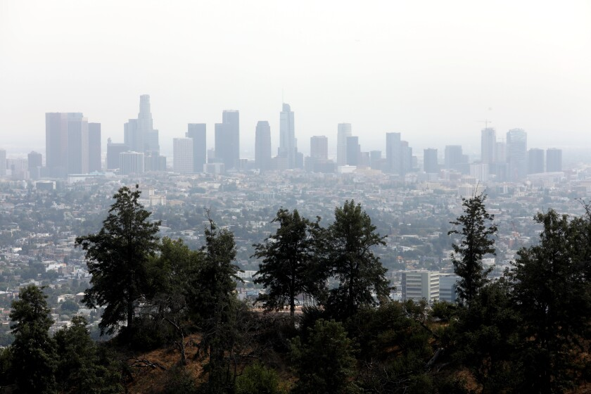 The Los Angeles skyline is shrouded in smoke from the Bobcat fire, as seen from the Griffith Observatory in Los Angeles.