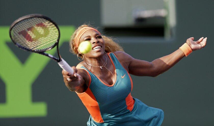 Serena Williams returns to Yaroslava Shvedova, of Kazakhstan, at the Sony Open tennis tournament in Key Biscayne, Fla., Thursday, March 20, 2014. (AP Photo/Alan Diaz)