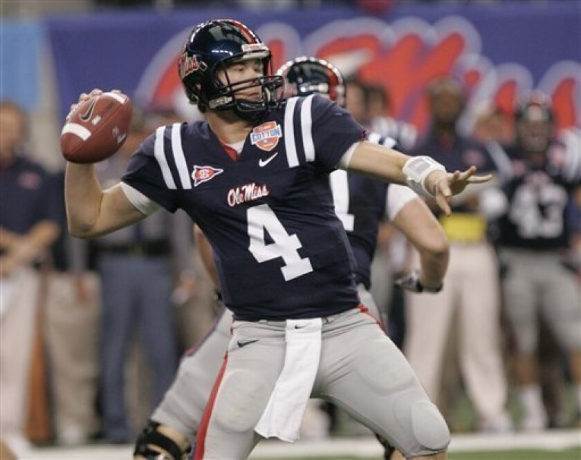 Mississippi quarterback Jevan Snead (4) throws a pass during the first half of the Cotton Bowl NCAA college football game against Oklahoma State at Cowboys Stadium Saturday Jan. 2, 2010 in Artlington, Texas. (AP Photo/Mike Fuentes)