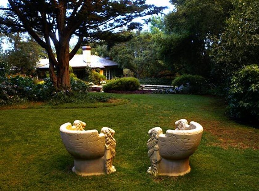By Emily Young Though the setting of this one-acre garden might seem quite traditional — a European-influenced home in Montecito — delve into the design and you'll find unusual plant combinations and unconventional choices by iconoclastic landscape designer Eric Nagelmann. Here, two Michael Taylor stone chairs provide a peaceful spot overlooking the backyard, with the surprises awaiting beyond.Though the setting of this garden might seem quite traditional — a European-influenced home in Montecito — delve into the design and you'll find unusual plant combinations and unconventional choices. Here, two Michael Taylor stone chairs provide a peaceful spot overlooking the backyard, with surprises awaiting beyond. Read the full story. Back to L.A. at Home