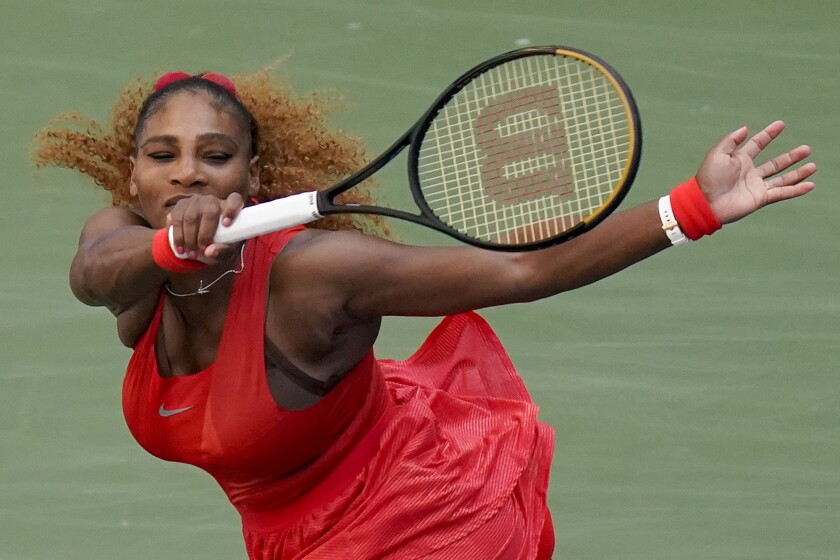 Serena Williams lunges to return a shot during a win over Sloane Stephens on Saturday at the U.S Open.