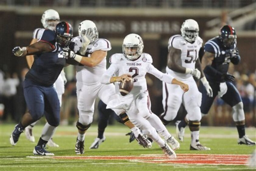 Texas A&M's Johnny Manziel (2) scrambles against Mississippi during an NCAA college football game, Saturday, Oct. 12, 2013 at Vaught-Hemingway Stadium in Oxford, Miss. (AP Photo/Oxford Eagle, Bruce Newman) MAGS OUT; NO SALES; MANDATORY CREDIT