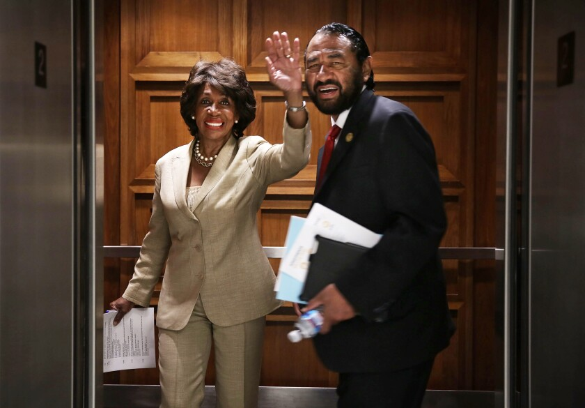Rep. Al Green (D-Texas), shown entering a Capitol Hill elevator in 2013 with Rep. Maxine Waters (D-Los Angeles), is forcing a House vote on his impeachment resolution Wednesday.