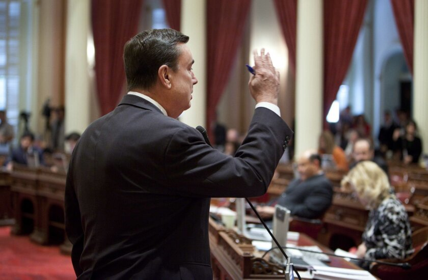 Sen. Joel Anderson, R-Alpine, speaks against a resolution to suspend three Democrats who face charges in criminal cases on the floor of the Senate in Sacramento, Calif., on Friday, March 28, 2014. The  resolution which passed 28-1 prevents Democratic Sens. Ron Calderon, Leland Yee and Rod Wright fr