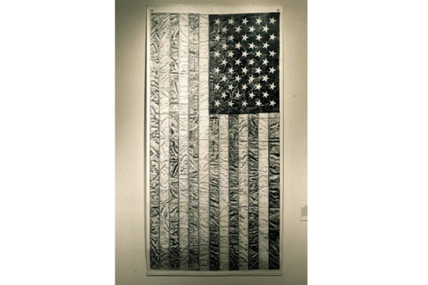 "Iana Quesnell's ""Burial Flag"" (graphite on paper, 2010) is one of two works by the San Diego artist in ""Women, War, and Industry"" at the San Diego Museum of Art."