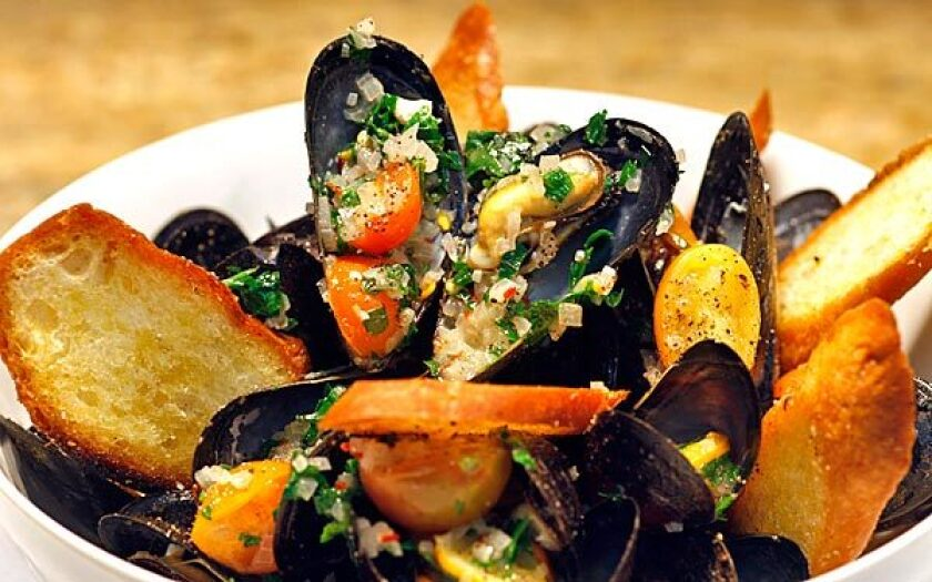 Steamed black mussels can be a starter to share or a main course.