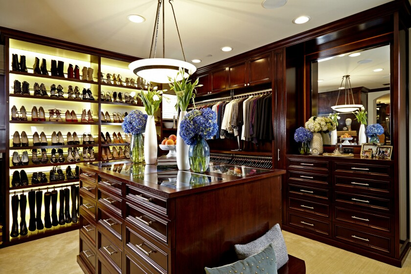 An 'island' is a popular feature in upscale closets.