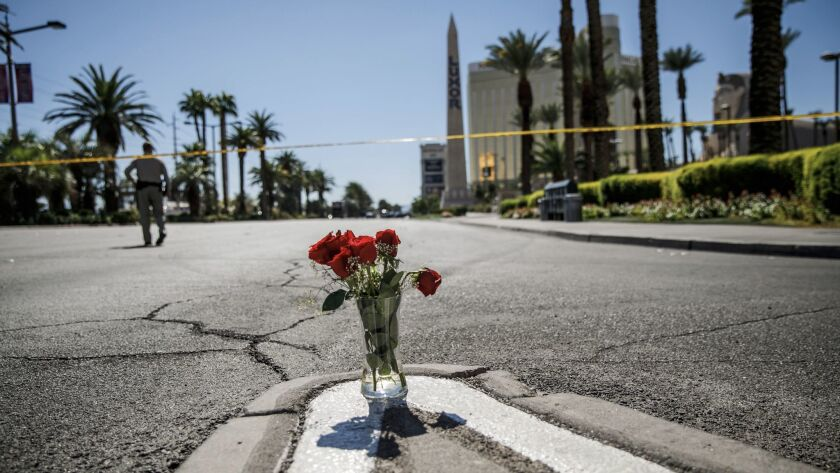 A vase of flowers was left on Las Vegas Boulevard and Reno Avenue Monday morning for the victims of the mass shooting in Las Vegas.