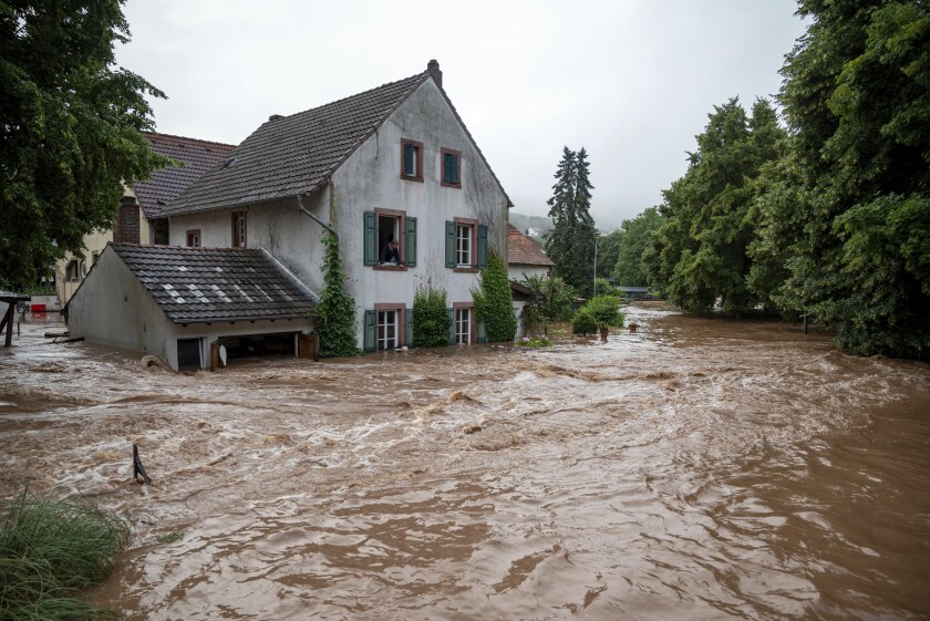Houses are partially submerged on overflowed river banks
