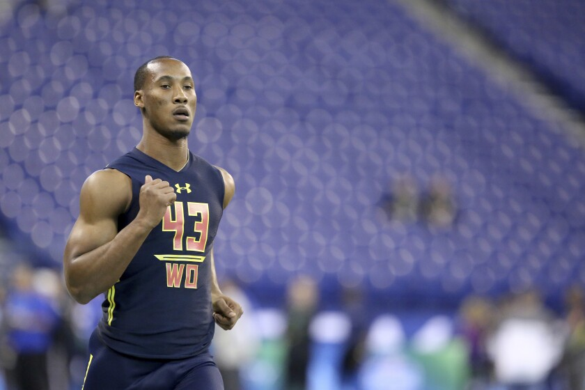 FILE - Florida State wide receiver Travis Rudolph runs a drill at the 2017 NFL football scouting combine in Indianapolis, in this Saturday, March 4, 2017, file photo. Former Florida State star football player Travis Rudolph was arrested early Wednesday, morning, April 7, 2021, in South Florida for a shooting that left one man dead and another wounded, authorities said. Rudolph, 25, was charged with first-degree murder and attempted first-degree murder, according to a Palm Beach County Sheriff's Office news release. (AP Photo/Gregory Payan, File)
