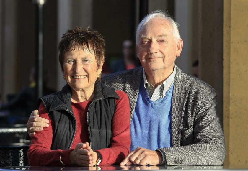 """Art collectors Sandy (left) and Bram Dijkstra have loaned """"Virgin of Sorrows"""" to the San Diego Art Museum for two years."""