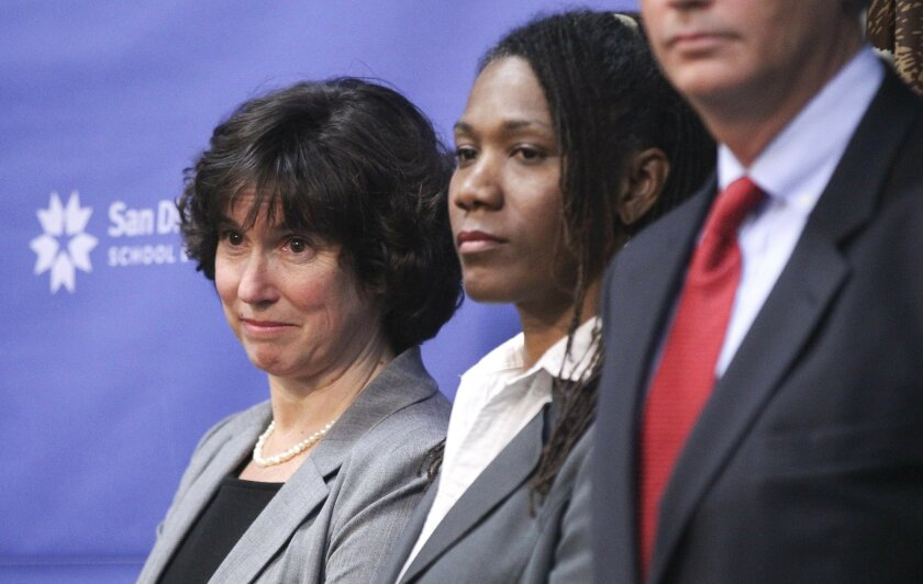 San Diego Unified school board President Marne Foster, center, with Superintendent Cindy Marten in 2013.