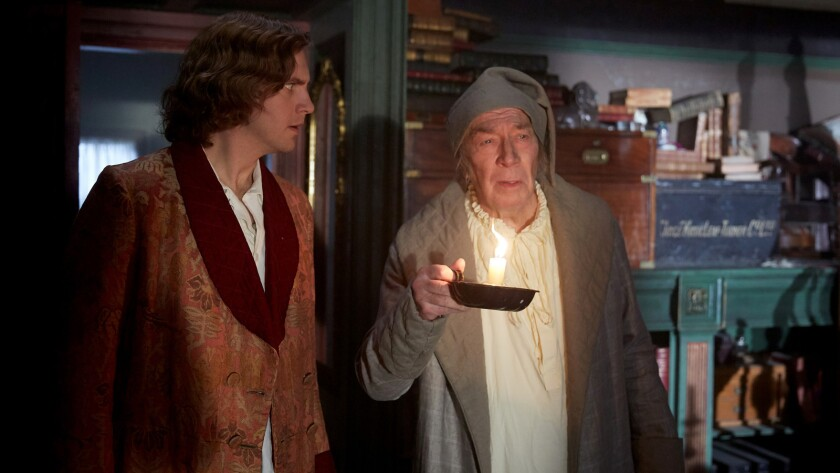 """Dan Stevens, left, and Christopher Plummer in the movie """"The Man Who Invented Christmas."""""""