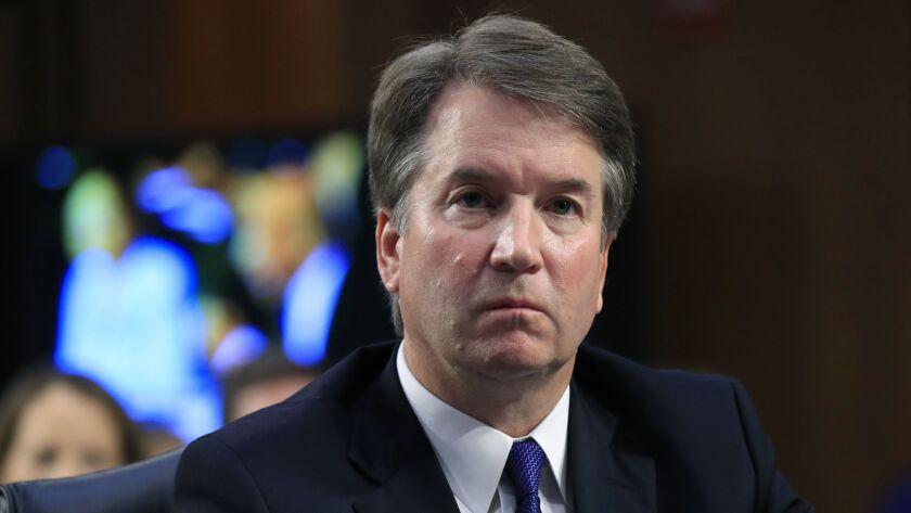Supreme Court nominee Brett M. Kavanaugh listens to Sen. Cory Booker (D-N.J.) during a Senate Judiciary Committee nomination hearing Sept. 4.