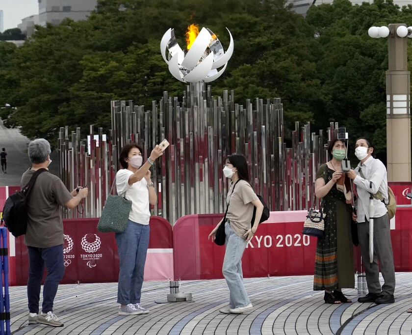 People photograph the Olympic Cauldron