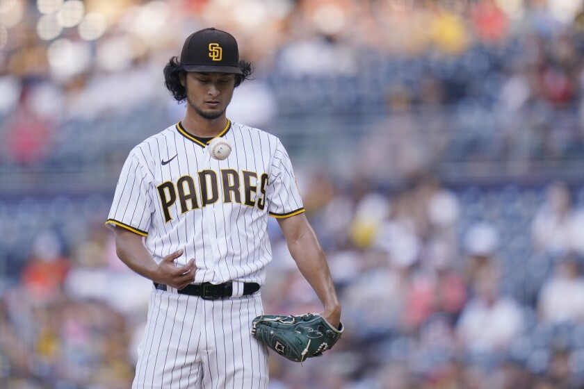 San Diego Padres starting pitcher Yu Darvish pauses during the first inning of the team's baseball game against the Los Angeles Dodgers on Wednesday, Sept. 8, 2021, in San Diego. (AP Photo/Gregory Bull)