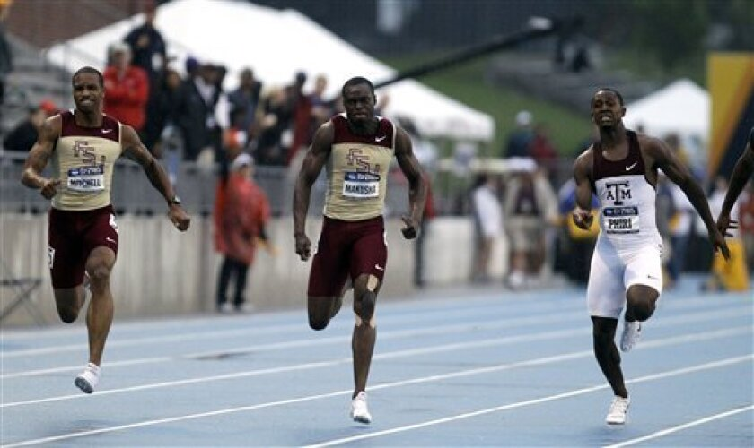 Florida State's Ngonidzashe Makusha, center, leads teammate Maurice Mitchell, left, and Texas A&M's Gerald Phiri, right, during the men's 100-meter dash final at the NCAA outdoor track and field championships on Friday, June 10, 2011, at Drake Stadium in Des Moines, Iowa. (AP Photo/Charlie Neibergall)