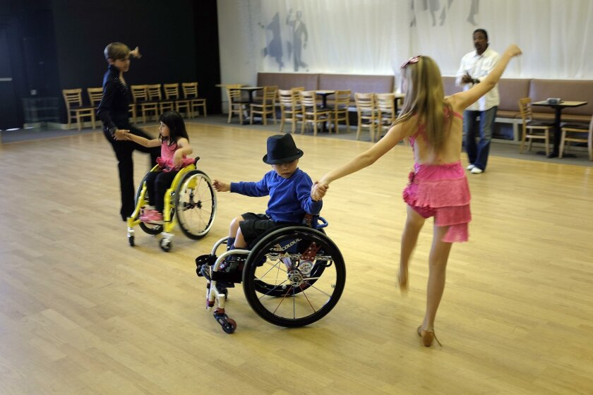 Wheelchair users Emma Mondragon and Angelo Sanchez rehearse with Gonzalo Allen-Perez and his sister Aitana Allen-Perez. Choreographer Joe Torres can be seen in the background.