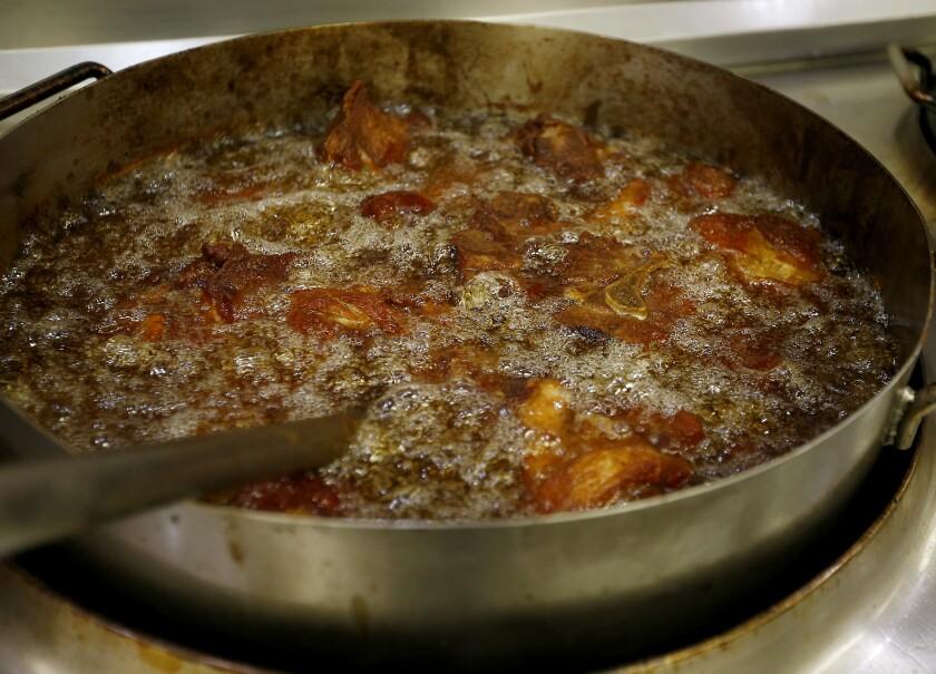 Hot and fresh carnitas is prepared at Northgate