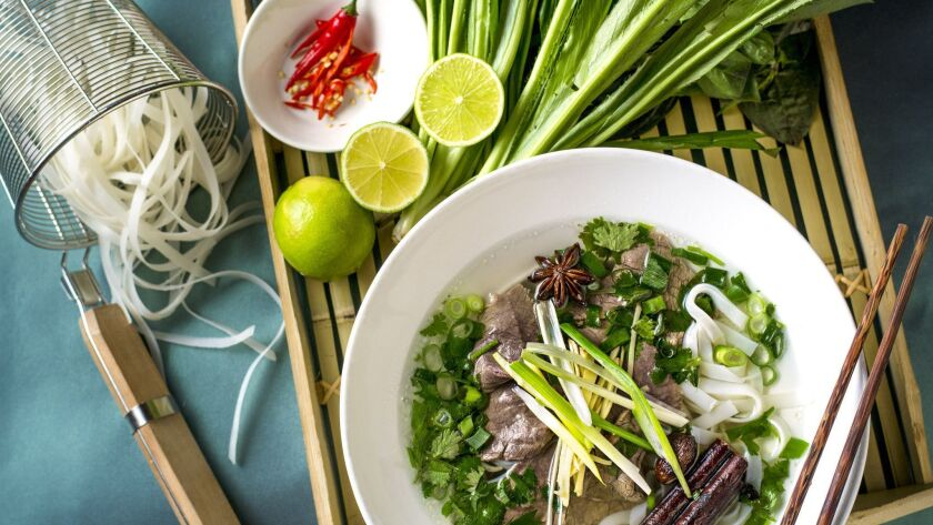 Pho Bo: Homemade beef broth with thin strips of Black Angus beef, Banh Pho flat rice noodles and fre