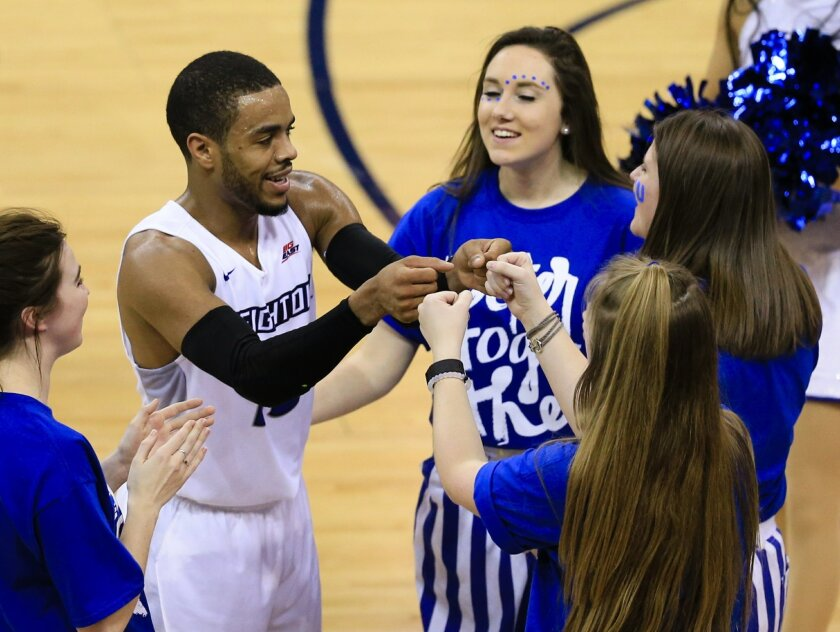 Creighton's Maurice Watson Jr. (10) celebrates with members of the cheering squad following the second half of an NCAA college basketball game against Xavier in Omaha, Neb., Tuesday, Feb. 9, 2016. Watson scored 32 poings in Creighton's win 70-56. (AP Photo/Nati Harnik)
