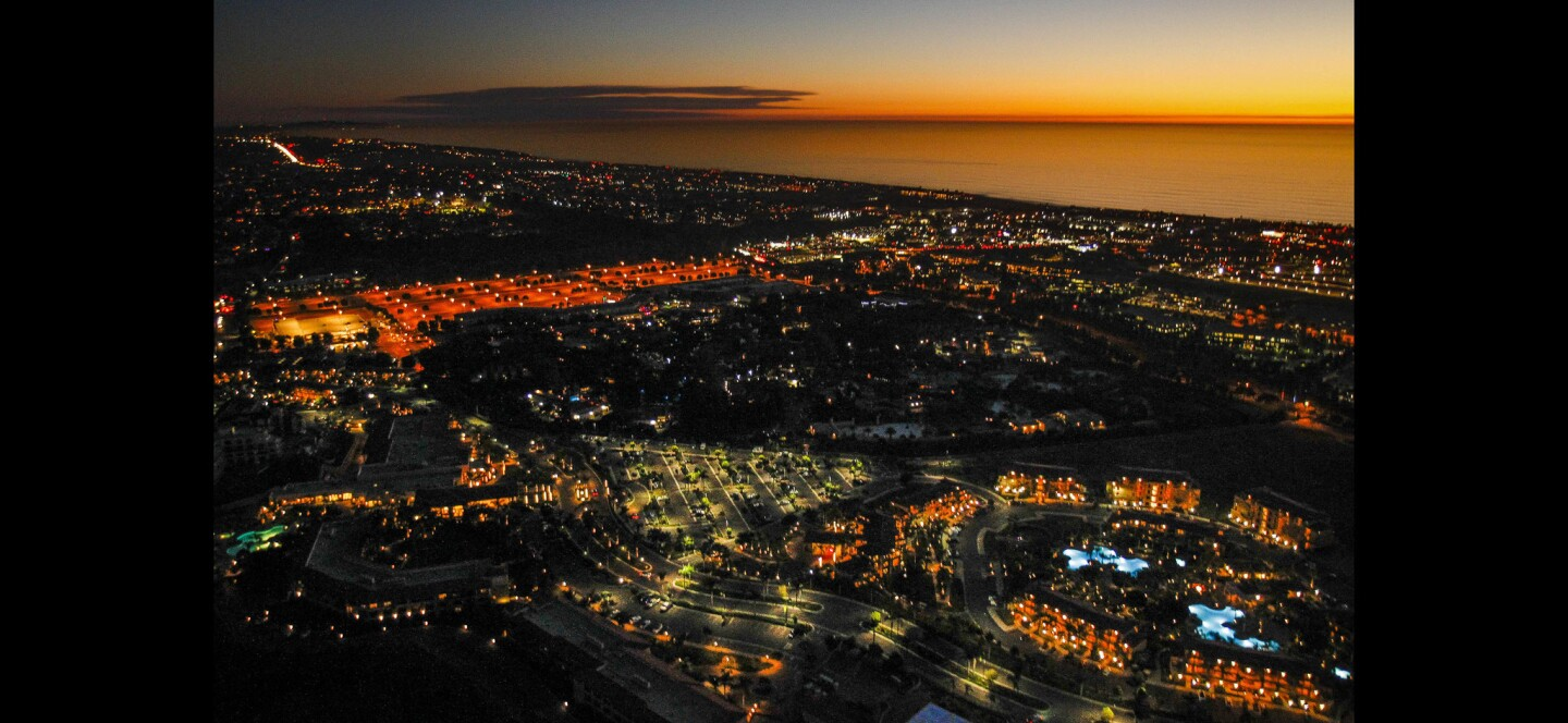 Carlsbad as viewed from Kurt Dawson's helicopter while he flies over over coastal North County after sunset.