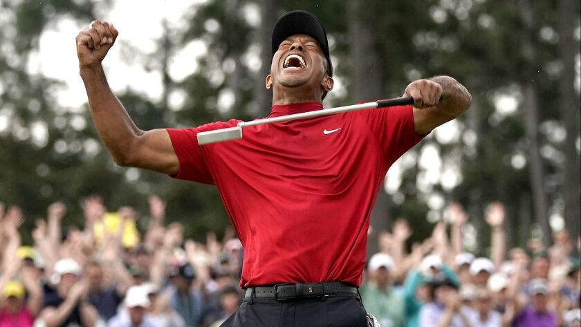 Tiger Woods reacts as he wins the Masters golf tournament Sunday, April 14, 2019, in Augusta, Ga. (A