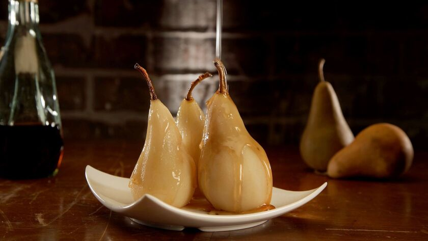 LOS ANGELES, CA., JANUARY 25, 2018-- Cooking with Hard Alcohol - Brandy-Poached Pears. (Kirk