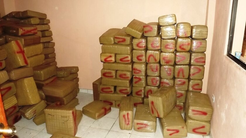 An anonymous call led to discovery of packages of drugs found Tuesday in an abandoned mechanic's shop in eastern Tijuana, authorities said.