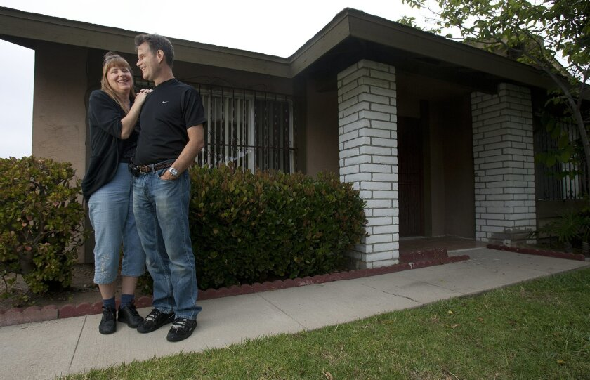 Patrice Butcher and her partner, Claye Moore, at their South Bay rental. (Click image to enlarge.)