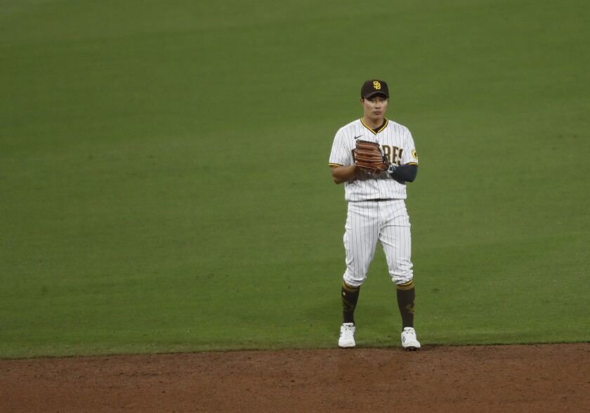 Ha-seong Kim plays shortstop for an injured Fernando Tatis Jr. against the San Francisco Giants at Petco Park on Monday.