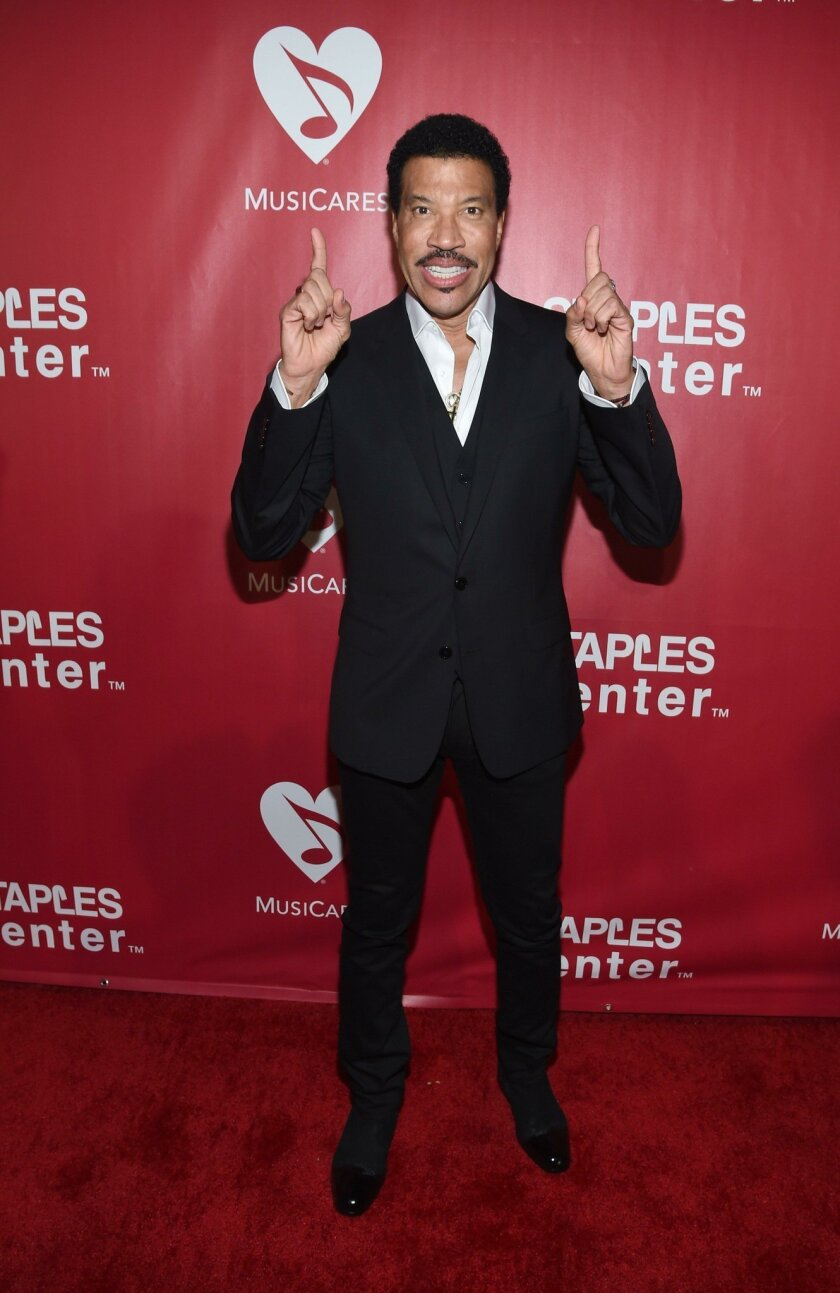 LOS ANGELES, CA - FEBRUARY 13:  Honoree Lionel Richie attends the 2016 MusiCares Person of the Year honoring Lionel Richie at the Los Angeles Convention Center on February 13, 2016 in Los Angeles, California.  (Photo by Larry Busacca/Getty Images for NARAS) ** OUTS - ELSENT, FPG, CM - OUTS * NM, PH