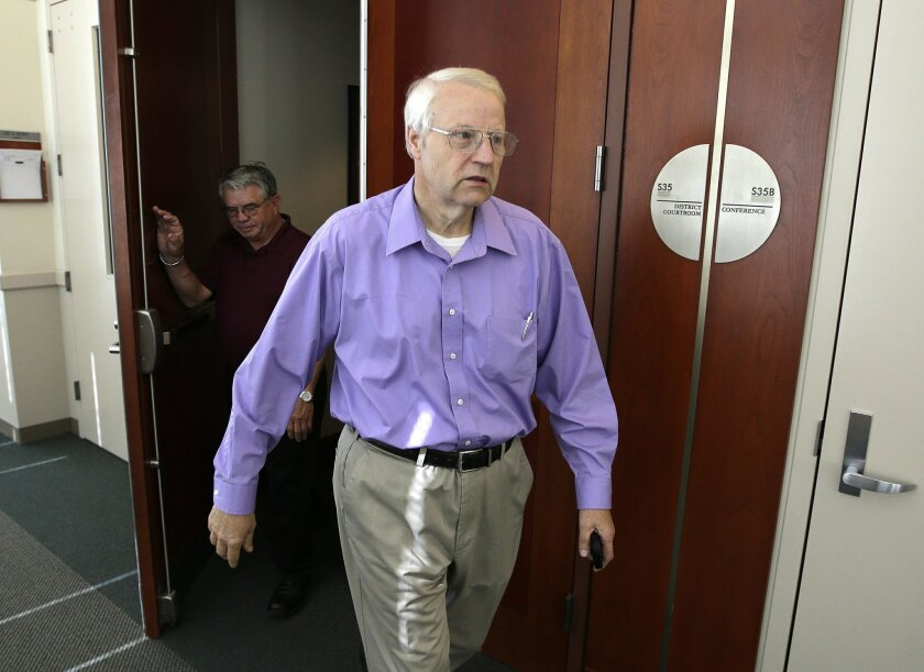 FILE - In this July 8, 2014, file photo, Charles Cox, the father of missing Utah mother Susan Powell walks out of the courtroom in Salt Lake City. Third District Judge L.A. Dever issued a ruling Wednesday. Sept. 3, 2014, that Cox was within his bounds to cut out Josh Powell's mother and sister from a trust that has $2 million in life-insurance proceeds. (AP Photo/Rick Bowmer, File)