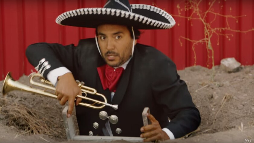 In the 360fly ad, a mariachi player is seen sneaking into America under Trump's border wall.