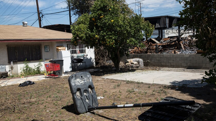 Yesenia Jaramillo's home is adjacent to the metal recycling facility that burned in Maywood.