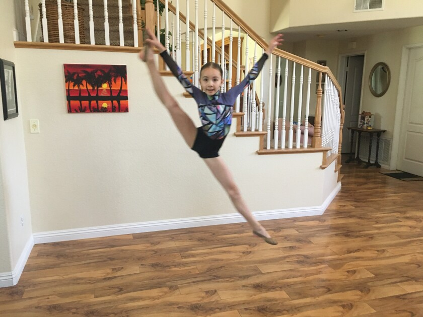 Fourth grader Karolina danced in her home.