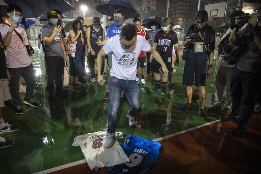 A demonstrator in Hong Kong stomps on LeBron James jerseys.