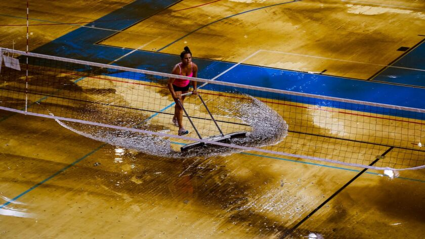 WESTWOOD, CA -- JULY 29, 2014--People work to remove water from the deluged floor of Wooden Court in