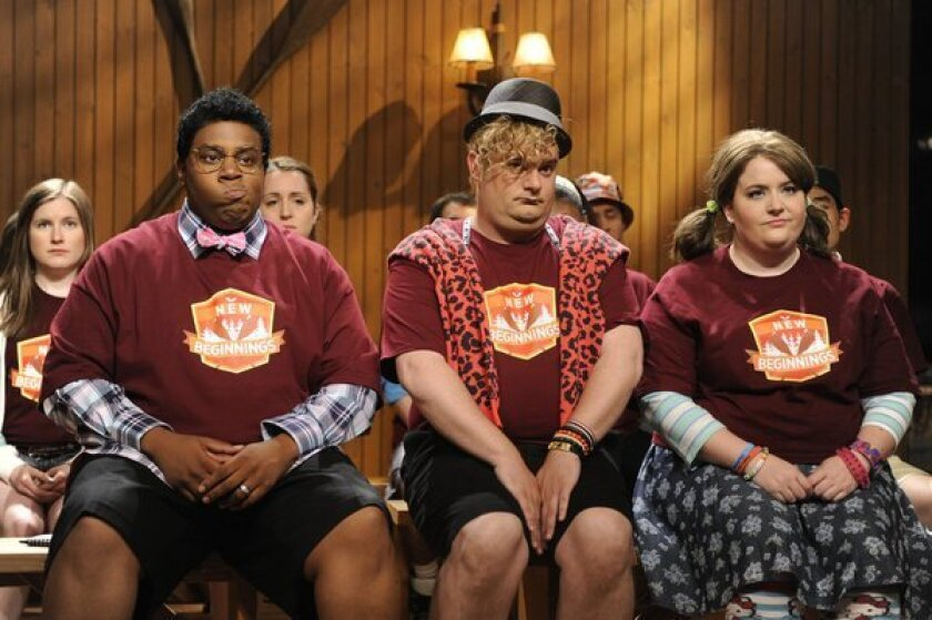 """Kenan Thompson (left, with Bobby Moynihan and Aidy Bryant) says he won't dress in drag anymore on NBC's """"Saturday Night Live."""""""