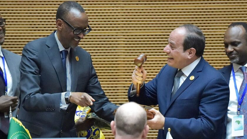 Egyptian President Abdel Fattah Sisi, right, speaks with outgoing African Union Chairman and Rwandan President Paul Kagame, after Sisi was elected the new chairman during the 32nd African Union summit in Addis Ababa, Ethiopia, on Feb. 10, 2019.
