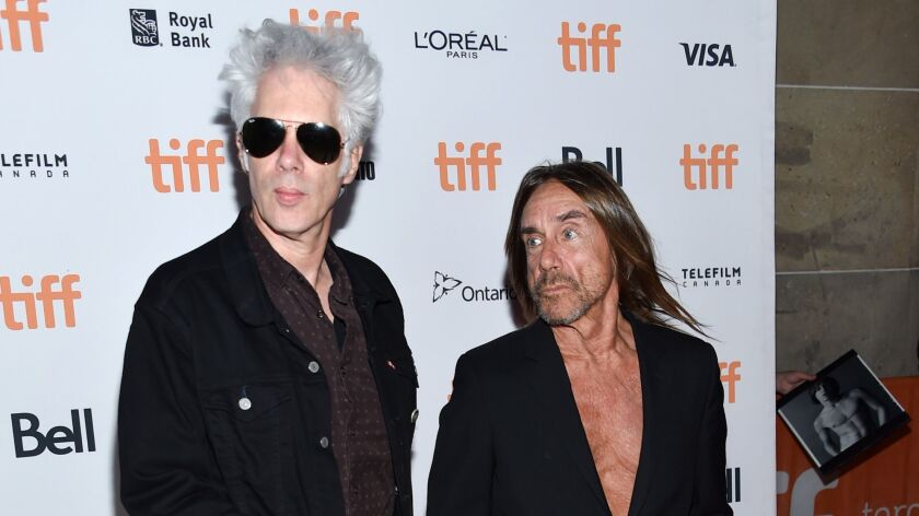 "Director Jim Jarmusch, left, and singer Iggy Pop attend the ""Gimme Danger"" premiere at the Toronto International Film Festival on Sept. 14."