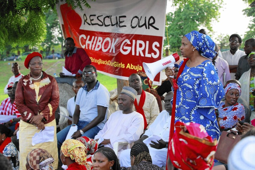 A woman makes a speech during a rally in Abuja calling on the Nigerian government to rescue the 276 schoolgirls held by the militant group Boko Haram.