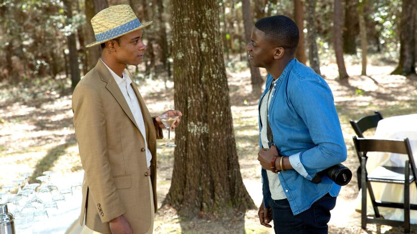 """Lakeith Stanfield as Logan, left, and Daniel Kaluuya as Chris in the film """"Get Out."""""""