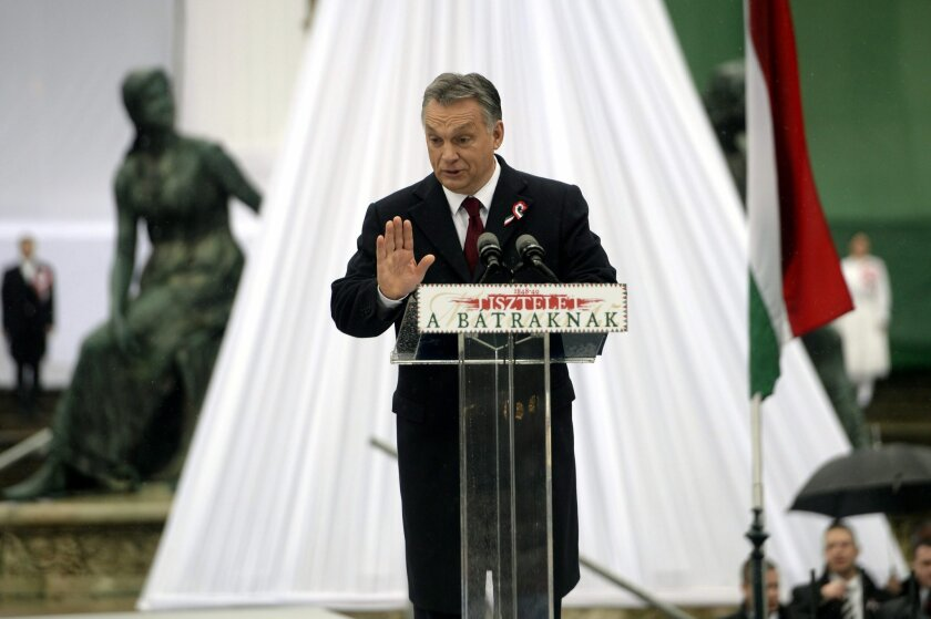 Hungarian Prime Minister Viktor Orban delivers a speech during a ceremony celebrating the national holiday, the 168th anniversary of the outbreak of the 1848 revolution and war of independence against the Habsburg rule at the Hungarian National Museum in Budapest, Hungary, Tuesday, March 15, 2016. (Tamas Kovacs/MTI via AP)