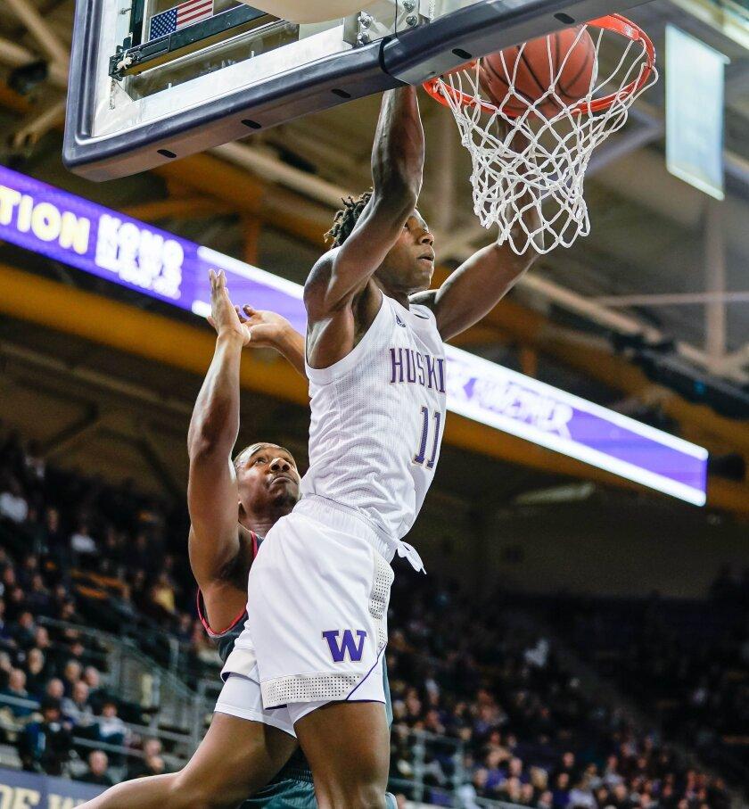 Washington's Nahziah Carter dunks against Eastern Washington during the first half of an NCAA college basketball game Wednesday, Dec. 4, 2019, in Seattle. (Dean Rutz/The Seattle Times via AP)
