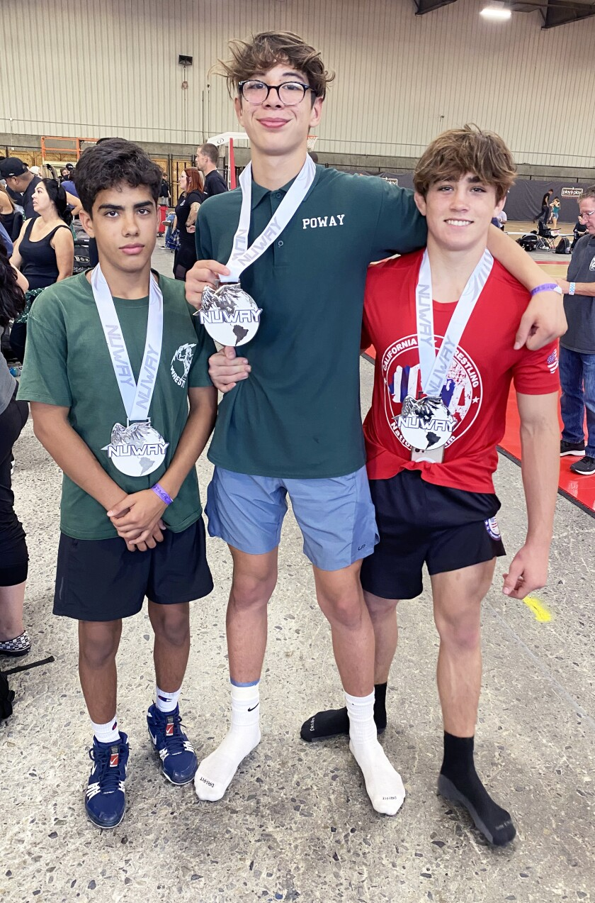 Edwin Sierra, Angelo Posada and Laird Root who won their weight classes at the San Diego Showboat Folkstyle Tournament.