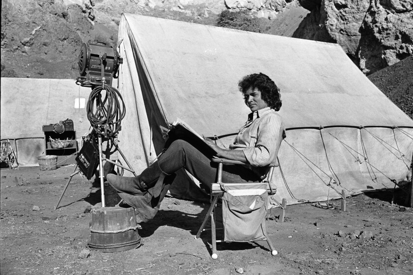 "Director and star Michael Landon takes break during filming of the television show ""Little House on the Prairie"" in 1976 to read a script."