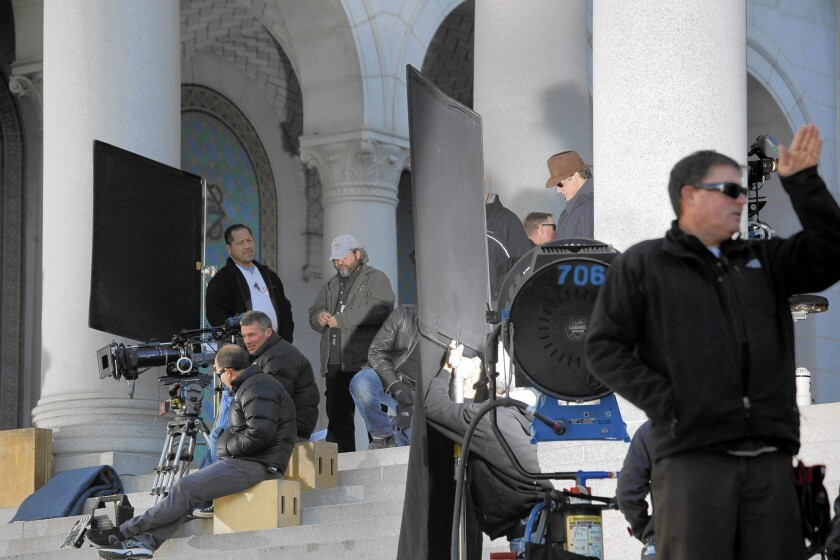 """Proposed legislation would extend the California film tax credit program until 2022. It would broaden eligibility to include big movie productions, all television series and provide a special incentive for shooting outside the traditional Los Angeles-centered area. Above, filming of """"Gangster Squad"""" at L.A. City Hall in 2011."""