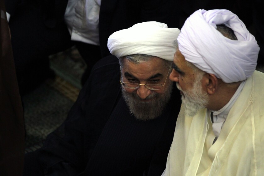 Iranian President-elect Hassan Rouhani, left, attends Friday prayers last week.