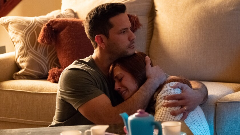 """(L-R)- Brooks Ryan (Doug) holding Ashley Bratcher (Abby Johnson) in a scene from """"Unplanned."""" Credit"""